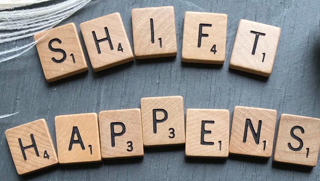 """Scrabble letter counters that read """"shift happens"""""""